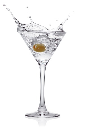 Splash from olive in a glass of cocktail, isolated on the white background