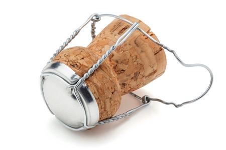 corcho: Corcho de la botella de champán, aislado en el fondo blanco