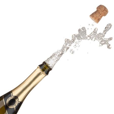 Champagne fles explosie, geà ¯ soleerd op de witte achtergrond Stockfoto