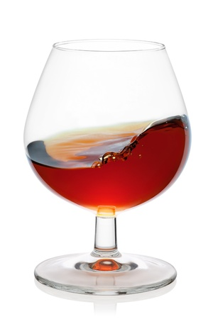snifter: Snifter glass with cognac splash, isolated on the white background, clipping path included