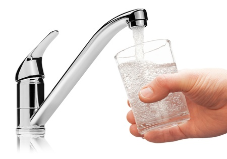 faucets: Glass filled with drinking water from tap, isolated on the white background