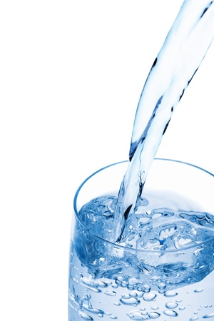 Water pouring into a glass, isolated on the white background, clipping path included