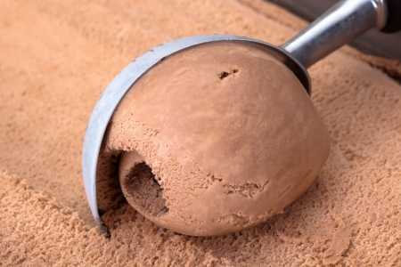 chocolate ice cream: Chocolate ice cream scooped out of container