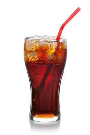 ESTONIA-JULI 09, 2014 Coca-Cola with ice cubes and straw in a glass, isolated on the white background, clipping path included