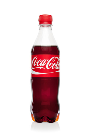 illustrative editorial:  ESTONIA - AUGUST 16, 2014  Coca-Cola drink bottle, isolated on the white background Coca-Cola Company is the leading manufacturer of soda drinks in the world  Illustrative editorial photo  Editorial