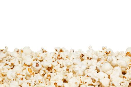 Closeup of popcorn border, isolated on the white background. photo