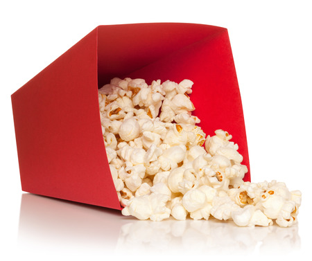 Red bucket with fallen out popcorn, isolated on the white background, clipping path included. photo