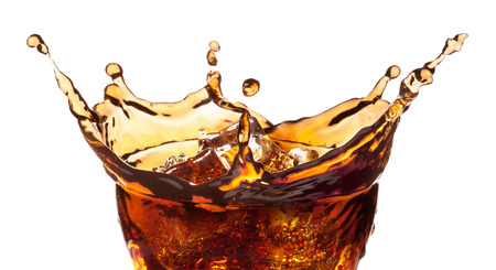 Splash from ice cubes in a glass of cola, isolated on the white background, clipping path included. Stockfoto