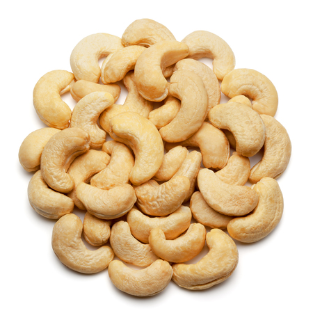 Closeup of cashew nuts, isolated on the white background, clipping path included.