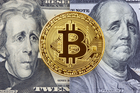 Golden bitcoin on dollar bills background with puzzled faces of American presidents. Archivio Fotografico