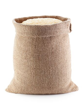 White rice in burlap sack, isolated on the white background.