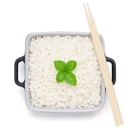 Rice with basil in ceramic bowl with wooden chopsticks, isolated on the white background, clipping path included.