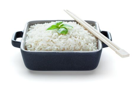Ready to eat rice in ceramic bowl with wooden chopsticks, isolated on the white background, clipping path included.
