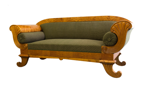 Antique Biedermeier sofa isolated with authentic fabricand woor carving Stock Photo