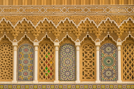 Islamic calligraphy and colorful geometric patterns Morocco. Stock Photo