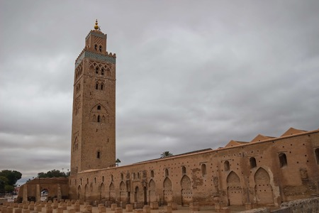 marocco: Morocco Marrakesh Koutoubia Mosque and Minaret in the late afternoon sunlight with dramatic sky Stock Photo