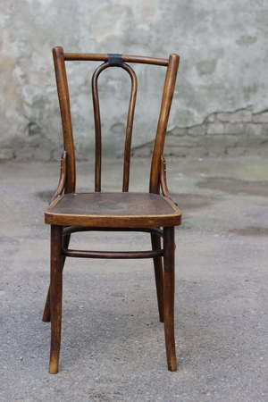 Antique Bentwood Viennese chair - Broken chair on the street. Stock Photo