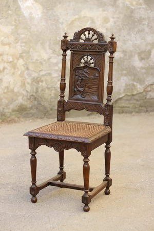 Old wooden chair furniture with carving Stock Photo