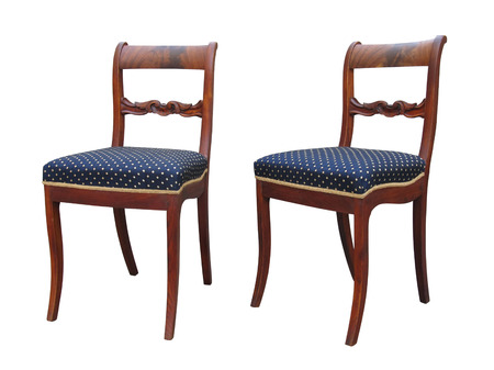 antique chair: Antique Biedermeier chair isolated with blue fabric and woor carving Stock Photo