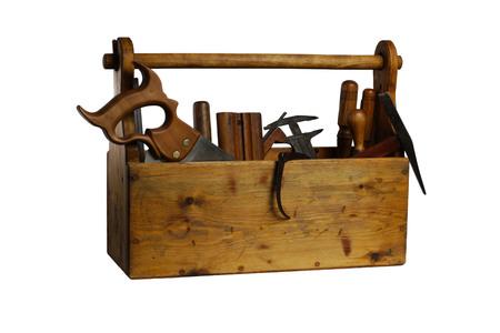 alicates: Caja de herramientas de madera vieja llena de herramientas aisladas