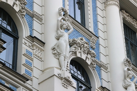 Facade of old building with sculptures - woman in Art Nouveau style Jugendstil Stock Photo