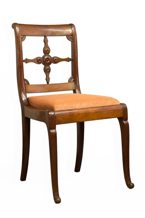 Antique Biedermeier chair isolated with orange fabric and wood carving Standard-Bild