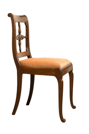 Antique Biedermeier chair isolated with orange fabric and wood carving Stock Photo