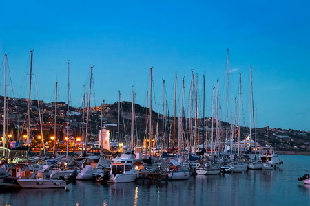 Italy, boats in the Sanremo marina harbor, sunset view
