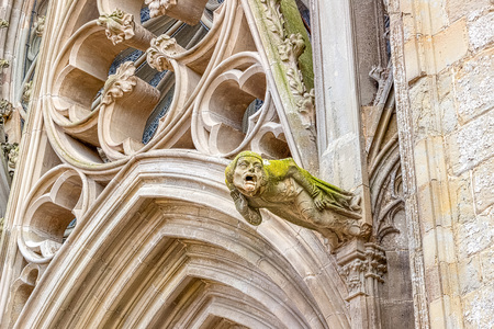 Gargoyles, which function as downspouts, protrude from the wall of Carcassonne Cathedral