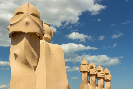 BARCELONA, SPAIN - July 9, 2017: Roof and chimneys of Casa Mila - La Pedrera. Casa Mila is a modernist building in Barcelona, was designed by Catalan architect Antoni Gaudi