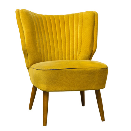 Old vintage yellow chair isolated on white