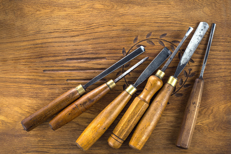 Set of wood chisel for carving wood, sculpture tools on wooden background Stock Photo