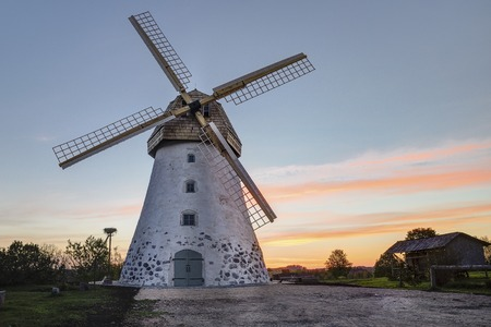 Traditional Old dutch windmill in Latvia. Sunrise view to Araisi windmill in Vidzeme.