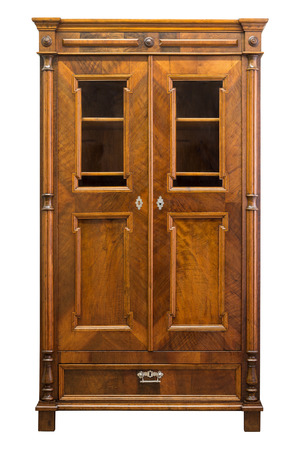 Antique wood and glass book case cabinet isolated on white Stock Photo