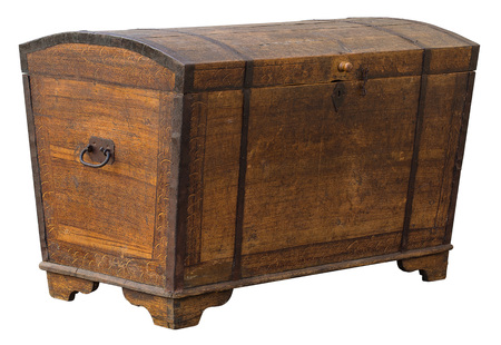 Old grungy wooden treasure chest with rusty metal decoration Stock Photo