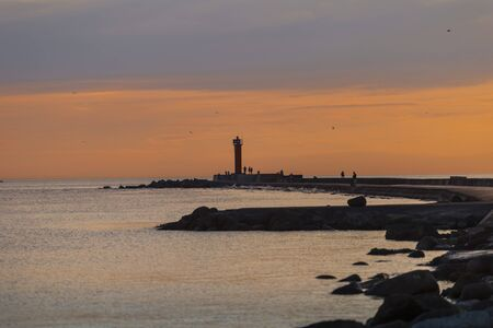 Lighthouse at the entrance to the port of Riga in the evening,
