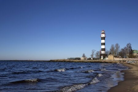 City Riga, Latvia. Lighthouse and mole at river Daugava.