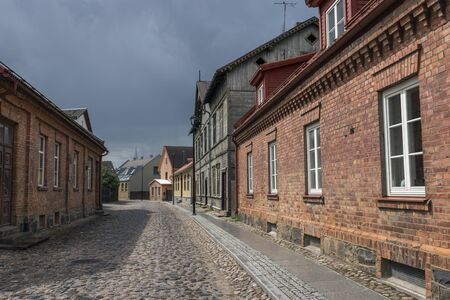 Street with old wooden colorful houses in old town of Viljandi Archivio Fotografico