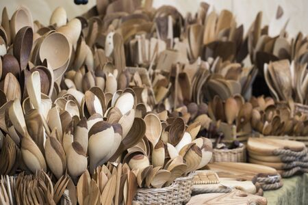 Wooden spoons. Household utensils are sold at the fair. Archivio Fotografico