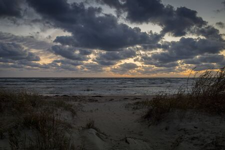 Storm clouds, storm Passing over Sea, dramatic clouds after storm Archivio Fotografico - 137414365