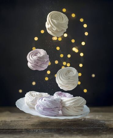 Flying homemade marshmallows. Levtating Pink marshmallows. Marshmallow with black currant. Archivio Fotografico - 138029895
