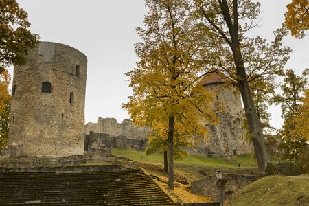 Autumn park with old castle ruins in Cesis town Archivio Fotografico - 139919105
