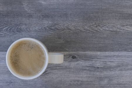 Coffee cup top view on grey wood table with copy space Archivio Fotografico - 142154155