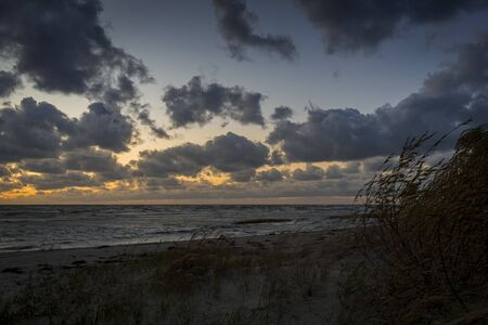 Storm clouds, storm Passing over Sea, dramatic clouds after storm Archivio Fotografico - 142154224