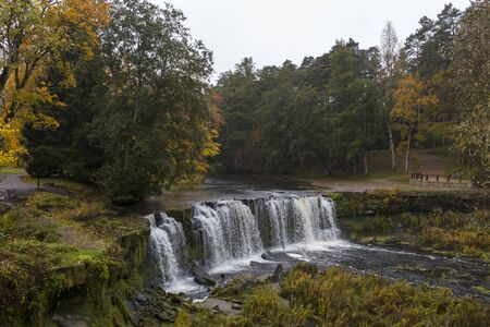 Waterfall Keila - Joa top view. Attraction in Estonia. Colorful autumn.