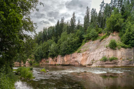 Gauja National Park. The Gauja rivers rocky shores of the red sandstone.