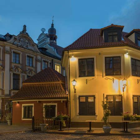 Narrow street illuminated of Old Town at night, Riga