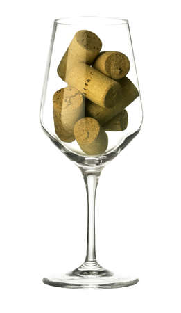 Wine glass and corks isolated on white Archivio Fotografico