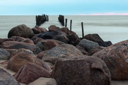 Remains of an old pier, old breakwater posts on beach, Lapmezciems, Riga Bay, Latvia
