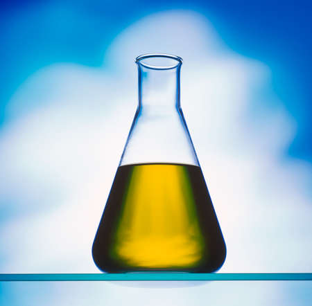 Biodiesel in CONICAL FLASK against blue background